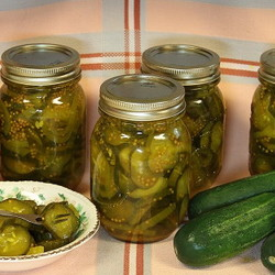 jars of pickles, cucumbers and bowl of pickles