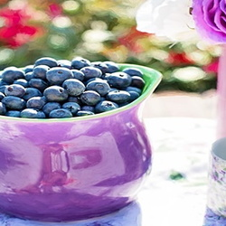 blueberries in a purple bowl