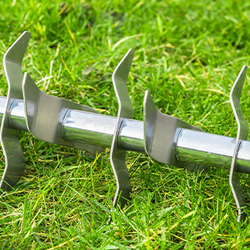 Metal Lawn Till on Grass