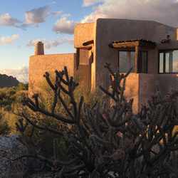 Desert Home with Cactus and Mountains