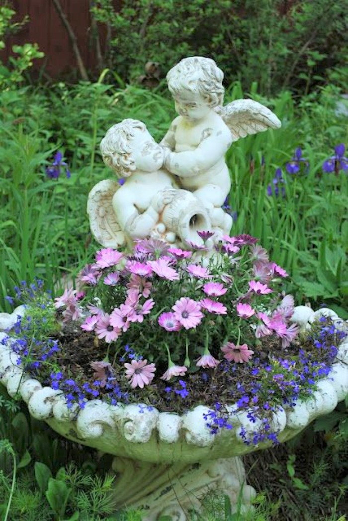 cherubs with pink and blue flowers