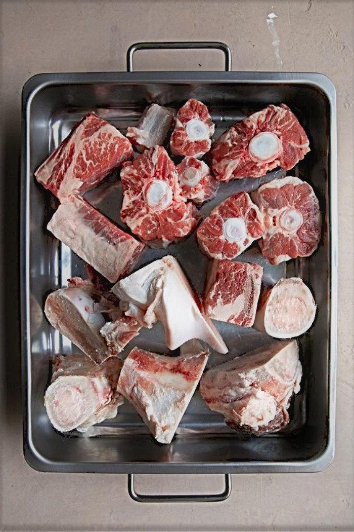 various meaty bones in a roasting pan