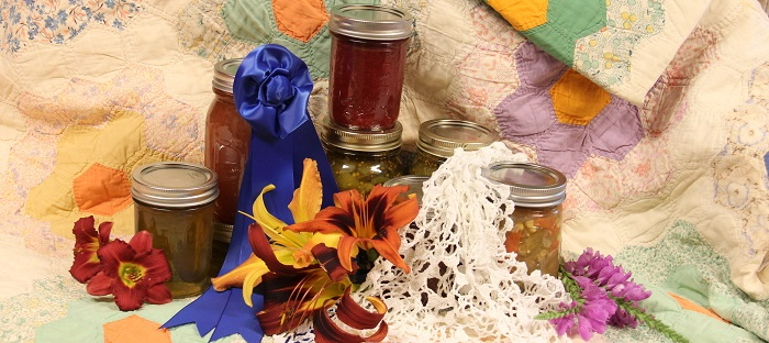 Quilt, canned goods, flowers and blue ribbon
