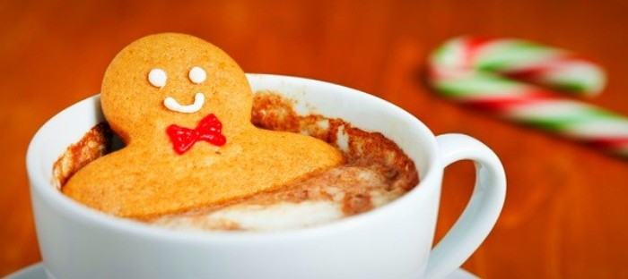 Gingerbread man in cup of cocoa