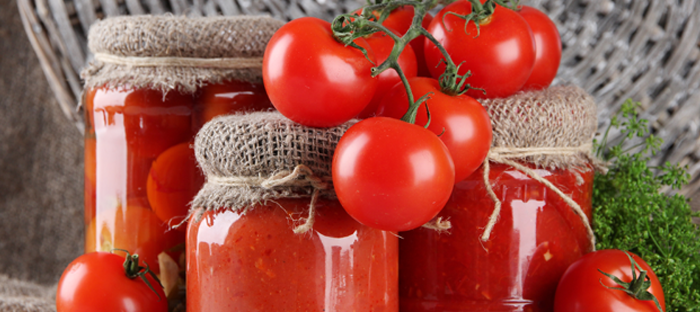 Fresh Tomatoes and Tomatoes in Glass Jars with Canvas Lids
