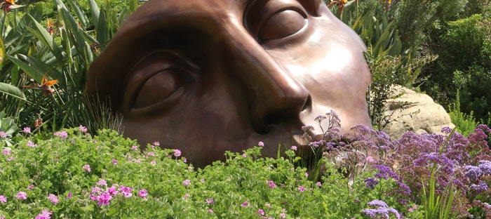 broken statue in a garden