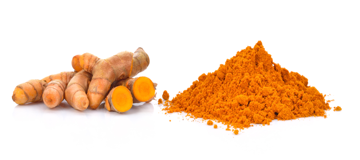 Tumeric root and mound of poweder