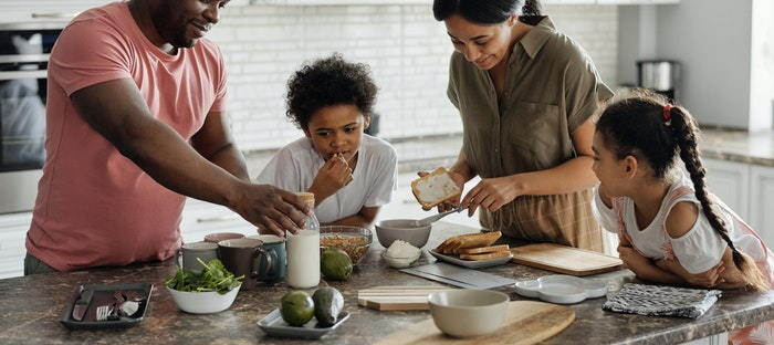 family preparing food on a counter
