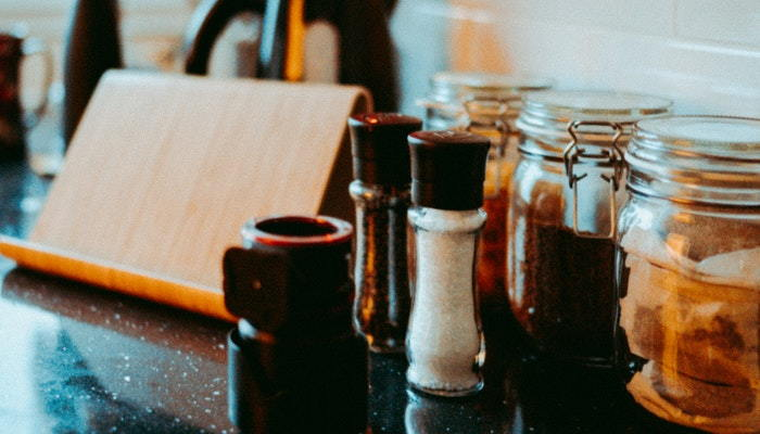 salt and pepper with spice containers