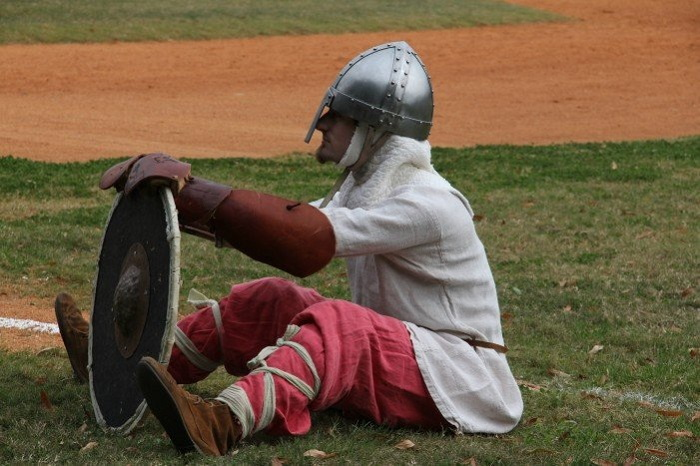 man in helment and holding a shield