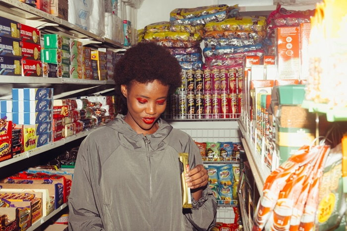 girl in a junk food aisle