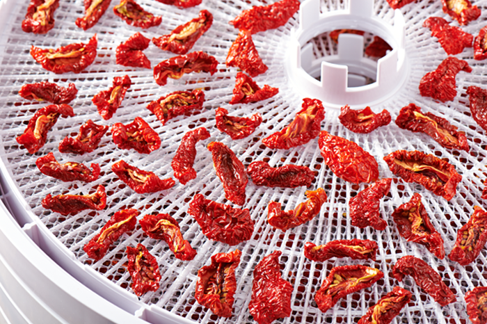 Tomatoes on a dehydrator tray