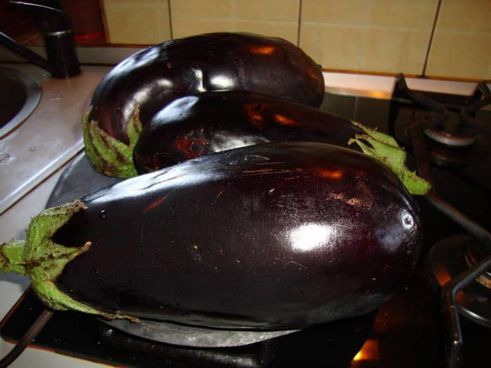 Eggplants roasting on the stove