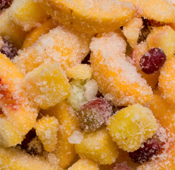 Frozen peaches and berries with frost on the surface