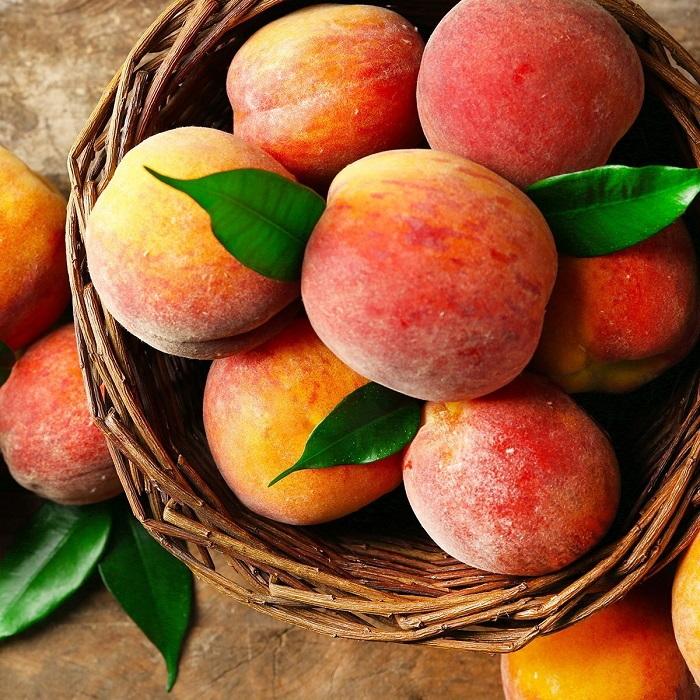 ripe peaches in a basket