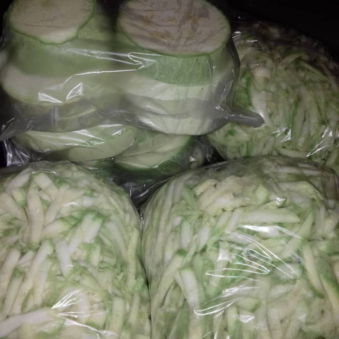 Slices and grated squash in plastic bags