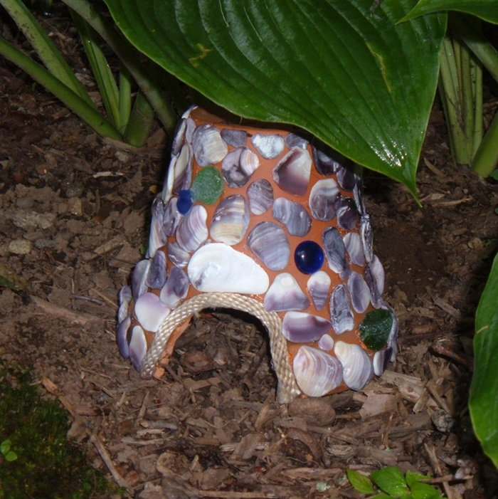 flowerpot turned into a toad house