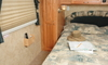The interior of a bed inside an RV.