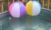 beach balls in a stock tank pool on a deck