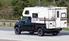 A truck with a camper.