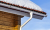 gutter, downspout, and snowy roof
