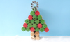 A Christmas tree made out of painted wine corks.