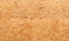 A close look at the texture of oriented strand board.