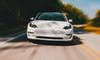 tesla model three electric car driving