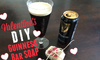 A can and glass of Guinness bear next to a bar of soap decorated for Valentine's Day.
