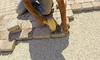 man installing paver stones
