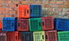 A stack of old milk crates, ready to be repurposed.