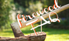 """An axe stuck in a stump with the words """"Firewood FAQ"""" over it."""