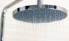 water dropping from large shower head