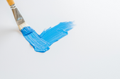 Blue paint brushed on a white background