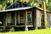 a small, remote cabin on stilt  foundation