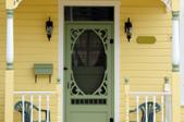 Yellow house with locking screen door