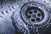water running down sink drain