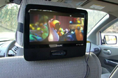 portable DVD player playing a movie in a car