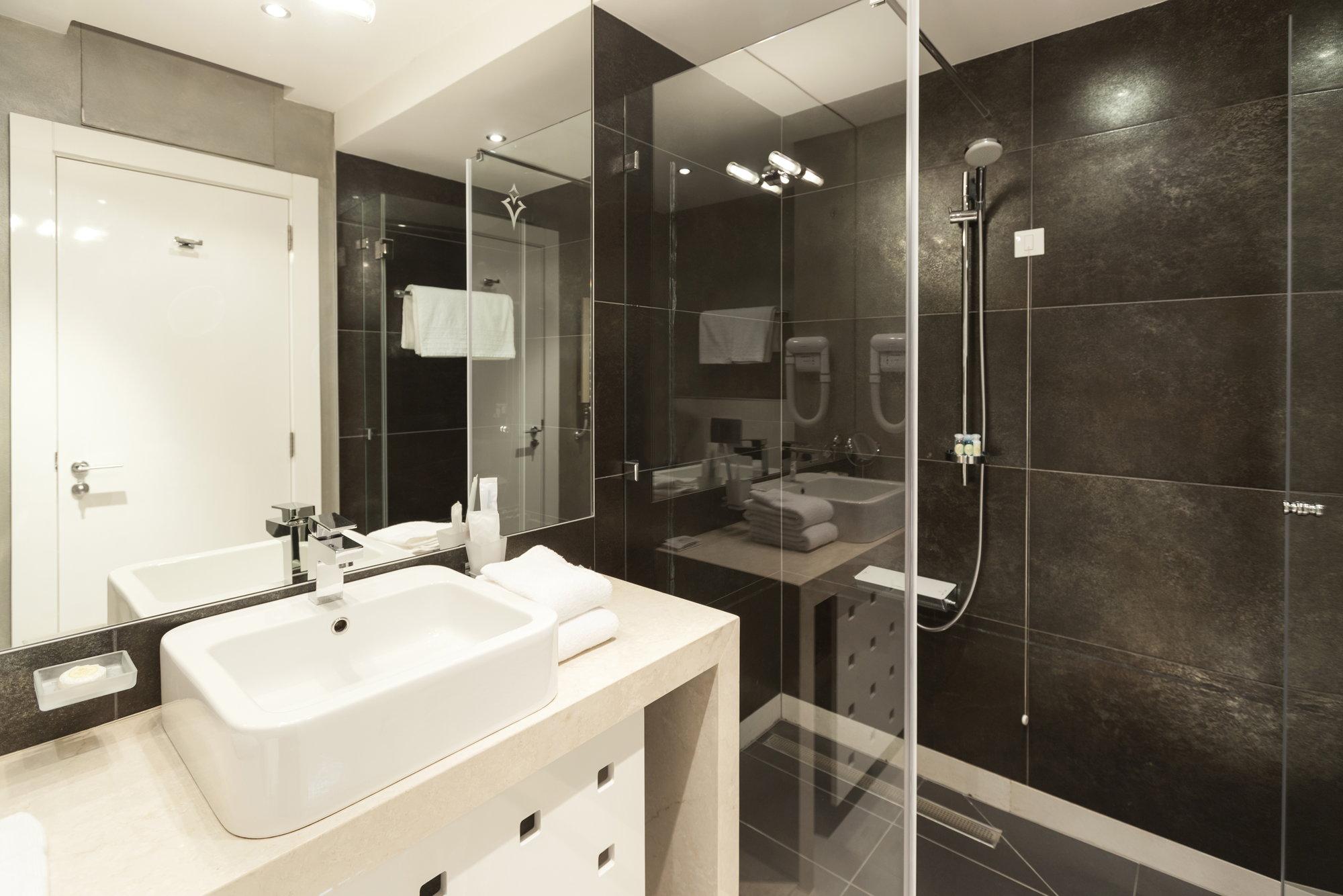 Water Spots On Black Tile Shower Floors