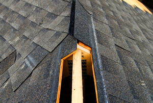 The hole for a ridge vent on a roof under construction.