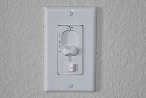 wall mounted switch with fan and light controls