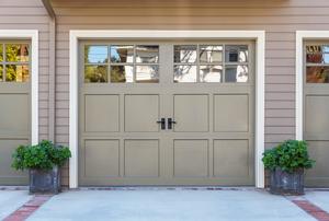 A garage door with windows on the top.