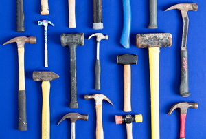 An array of hammers on a blue background.