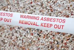 "Safety tape that reads, ""Warning Asbestos Removal, Keep Out"""