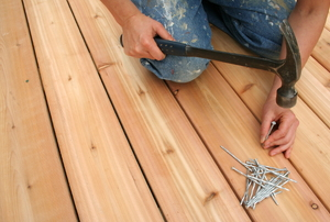 A man works on a deck.
