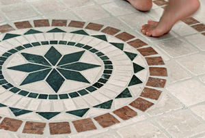 Bare feet on a mosaic tile floor.