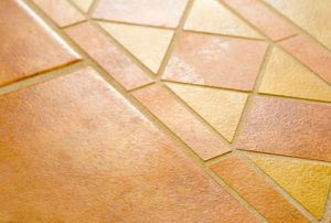 yellow and terra cotta colored floor tiles