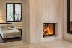 A room with a glass fireplace cover.