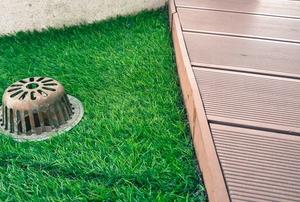 drain in grass floor on deck