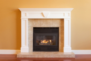 A framed fireplace with a gas insert.